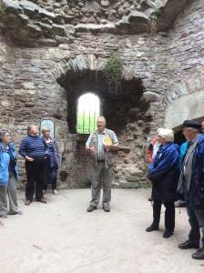 Dr John Kenyon in the kitchen of Raglan Castle